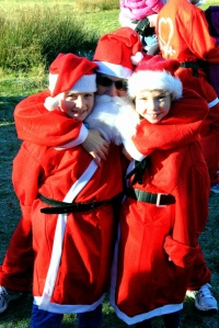 People dressed up for the sponsored Santa Run